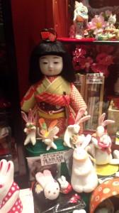 doll in chopstick shop