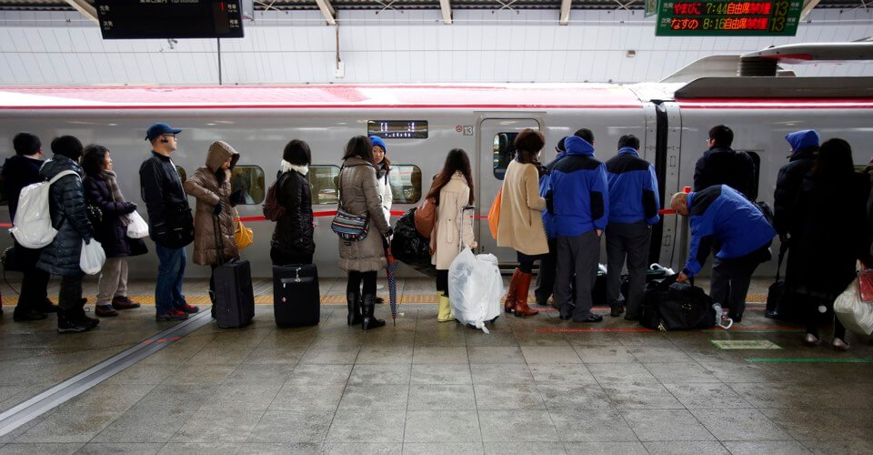 Japanese people lining up for train